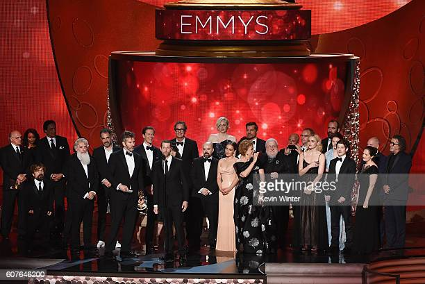 Writer/producers David Benioff and DB Weiss with cast and production team accept Outstanding Drama Series for 'Game of Thrones' onstage during the...