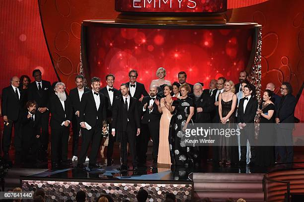 Writer/producers David Benioff and DB Weiss with production crew accept Outstanding Drama Series for 'Game of Thrones' onstage during the 68th Annual...