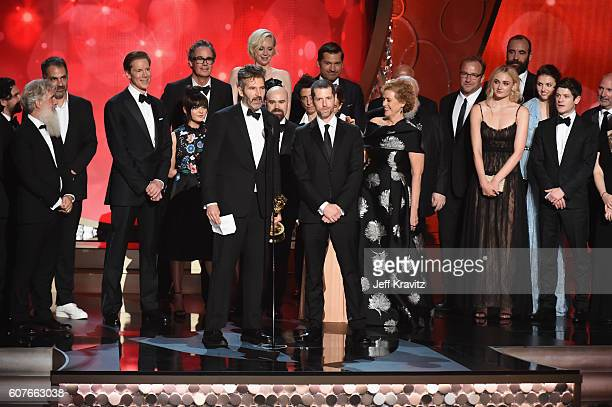 Writer/producers David Benioff and DB Weiss with production crew accept the award for Outstanding Drama Series for 'Game of Thrones' onstage during...