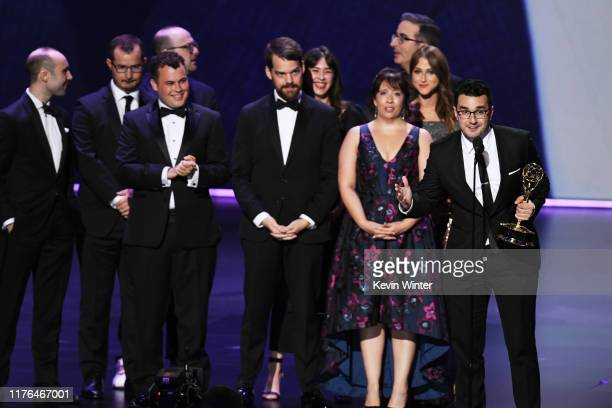 Writers accepts the Outstanding Writing for a Variety Series award for 'Last Week Tonight with John Oliver' onstage during the 71st Emmy Awards at...