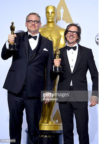 Writers Adam McKay and Charles Randolph winners of the Best Writing award for 'The Big Short' pose in the press room during the 88th Annual Academy...