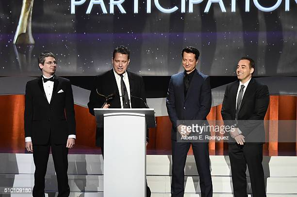 Writers Alex Chauvin Grant Taylor Dwight D Smith and Michael Agbabian accept the Quiz and Participation Award for 'Hollywood Game Night' onstage...