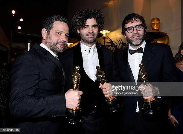 Writers Alexander Dinelaris Armando Bo and Nicolas Giacobone winners of Best Original Screenplay for 'Birdman' attend the 87th Annual Academy Awards...