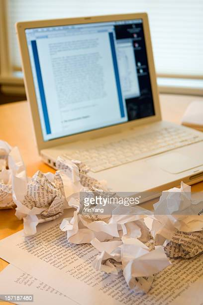writer's block, frustration in writing with laptop and crumpled paper - the_writer's_block stock pictures, royalty-free photos & images