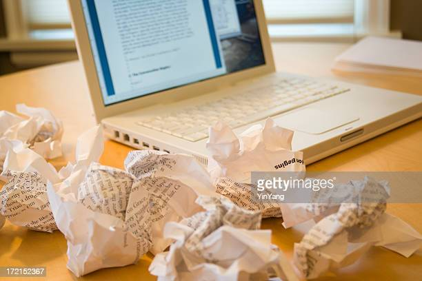 writer's block or writing frustration via laptop computer, crumpled paper - the_writer's_block stock pictures, royalty-free photos & images