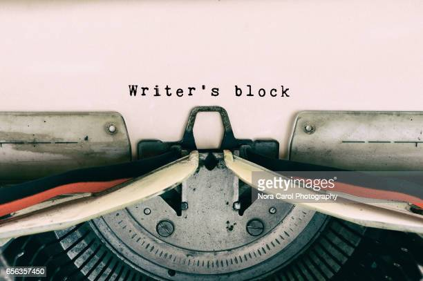 writer's block words typed on vintage typewriter - the_writer's_block stock pictures, royalty-free photos & images