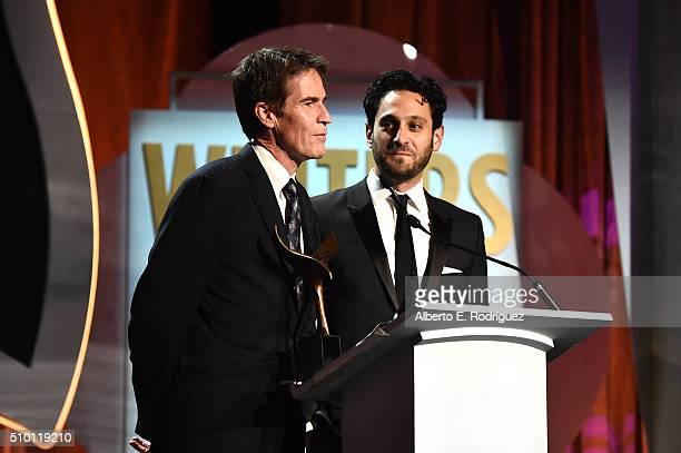 Writers Chip Johannessen and Seth Fisher winners of the award for Outstanding Writing Original Long Form for 'Saints Strangers' speak onstage during...