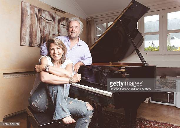 Writers Frederic Lenoir and Simonetta Greggio are photographed for Paris Match on May 29 2013 in Paris France