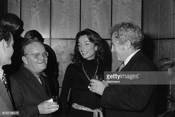 Writers get together at a cocktail party in New York December 19th. Truman Capote and Norman Mailer share the literary limelight with Princess Lee...