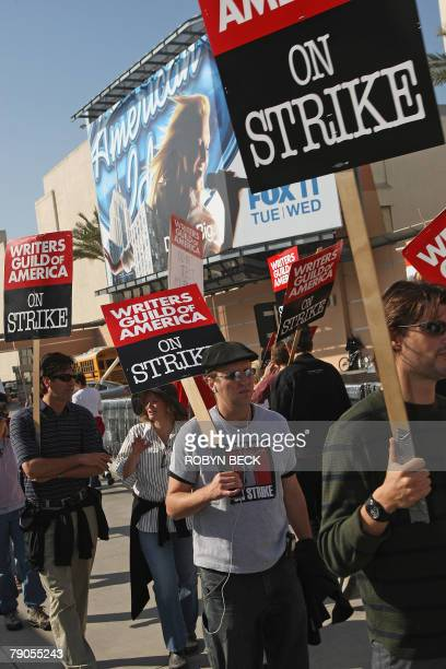 Writers Guild of America West and their supporters walk the picket line outside 20th Century Fox Studios in Los Angeles 16 January 2008 The WGA West...