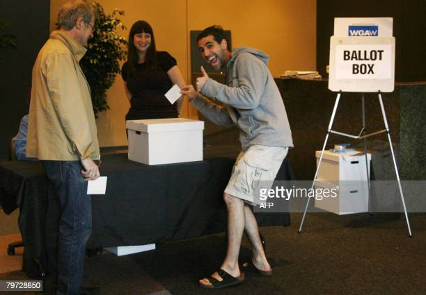 Writers Guild of America West member Steven Binder gives a thumbs up as he casts his ballot at the Writers Guild Theater in Beverly Hills on February...