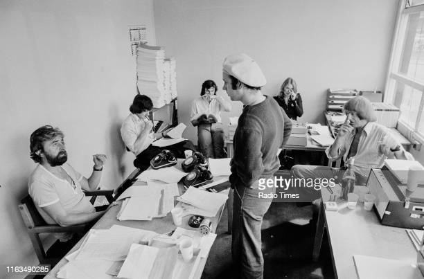 Writers Ian MacNaughton Michael Palin Terry Jones Neil Innes unknown and Graham Chapman in a script conference for BBC television show 'Monty...