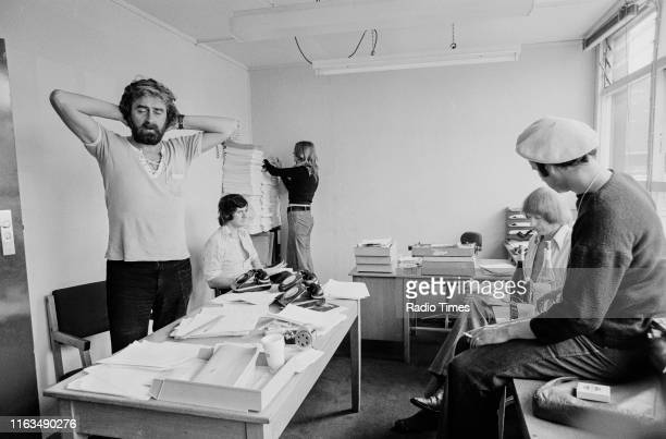 Writers Ian MacNaughton Michael Palin unknown Graham Chapman and Neil Innes in a script conference for BBC television show 'Monty Python's Flying...