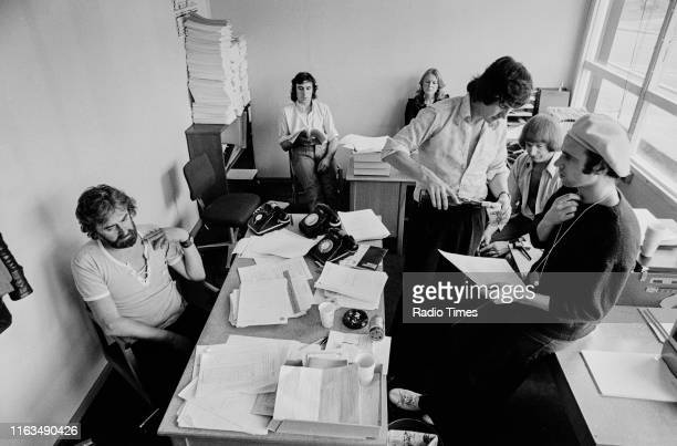Writers Ian MacNaughton Terry Jones unknown Michael Palin Graham Chapman and Neil Innes in a script conference for BBC television show 'Monty...