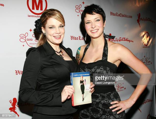 Writers Lily Burana and Diablo Cody pose with Burana's book I Love a Man in Uniform at the Operation Bombshell benefit event at Trader Vic's on May...