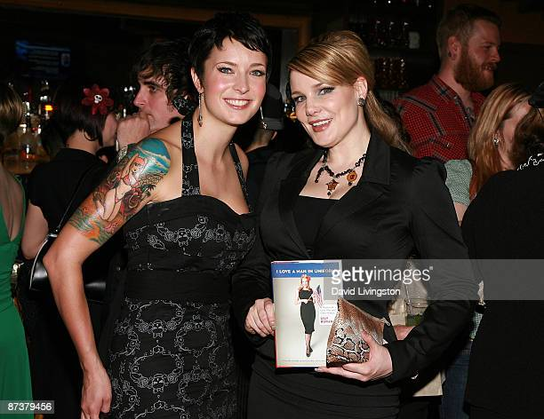 Writers Lily Diablo Cody and Lily Burana pose with Burana's book I Love a Man in Uniform at the Operation Bombshell benefit event at Trader Vic's on...