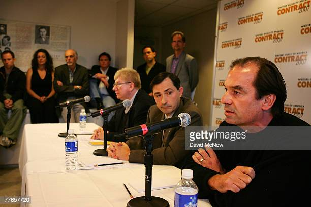 Writers look on as Writers Guild of America East President Michael Winship Writers Guild of America West President Patric Verrone and WGA Negotiating...