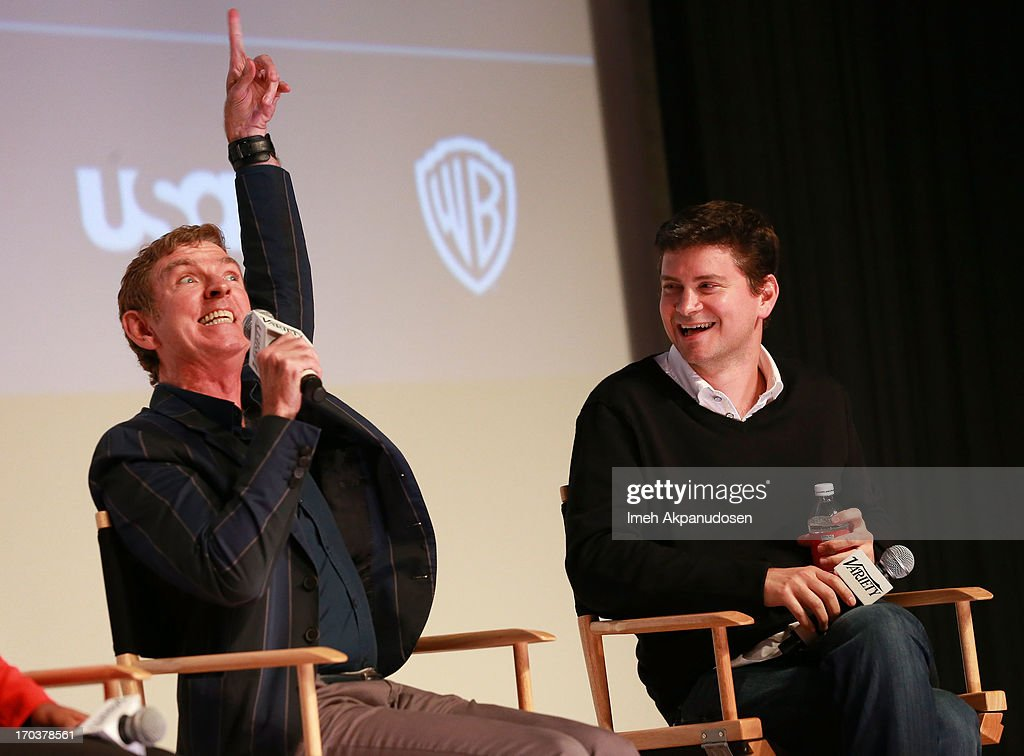 Writers Michael Patrick King (L) and Mike Schur speak onstage during Variety's A Night In The Writers' Room at Writers Guild Theater on June 11, 2013 in Beverly Hills, California.
