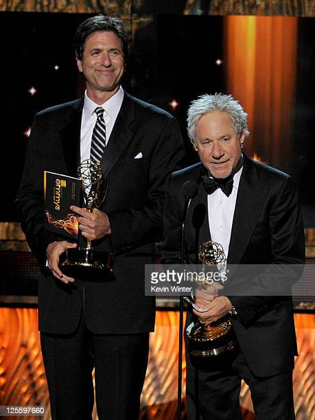 Writers Steven Levitan and Jeffrey Richman accept the Outstanding Writing for a Comedy Series award onstage during the 63rd Annual Primetime Emmy...