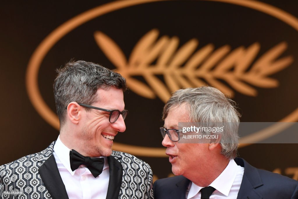 US writer/screenwriter Brian Selznick (L) talks with US director Todd Haynes as they arrive on May 18, 2017 for the screening of the film 'Wonderstruck' at the 70th edition of the Cannes Film Festival in Cannes, southern France. / AFP PHOTO / Alberto PIZZOLI
