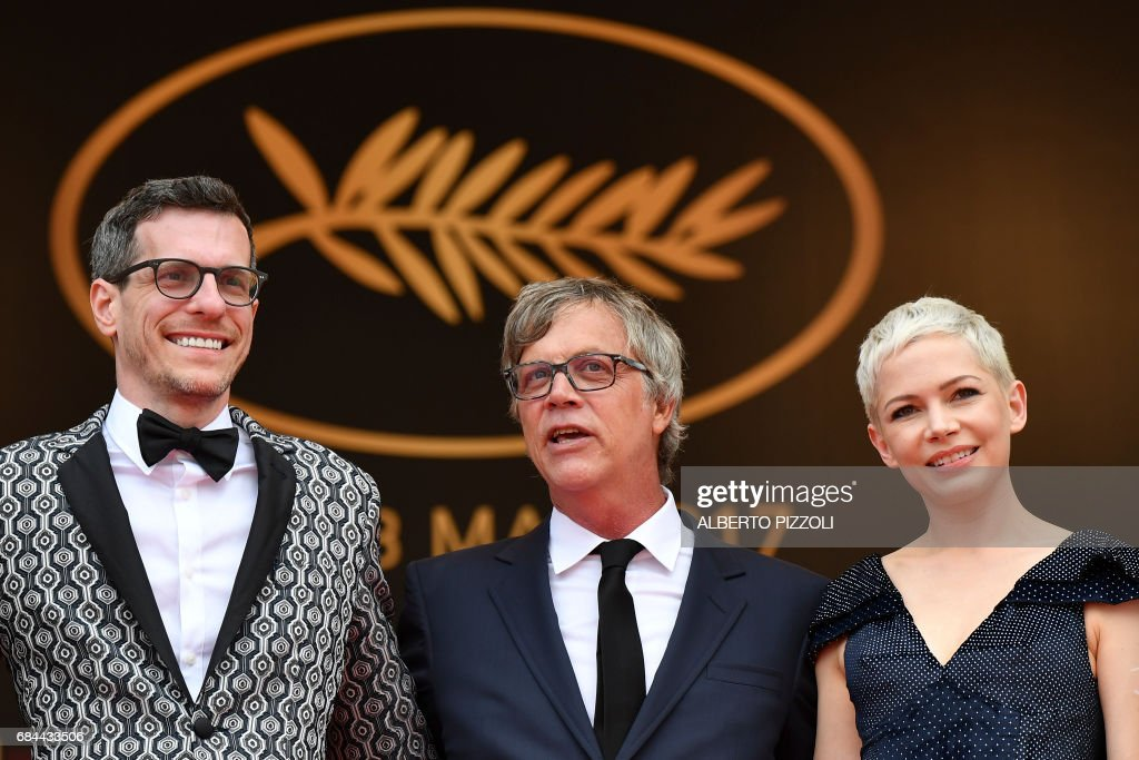 US writer/screenwriter Brian Selznick, US director Todd Haynes and US actress Michelle Williams pose as they arrive on May 18, 2017 for the screening of their film 'Wonderstruck' at the 70th edition of the Cannes Film Festival in Cannes, southern France. / AFP PHOTO / Alberto PIZZOLI