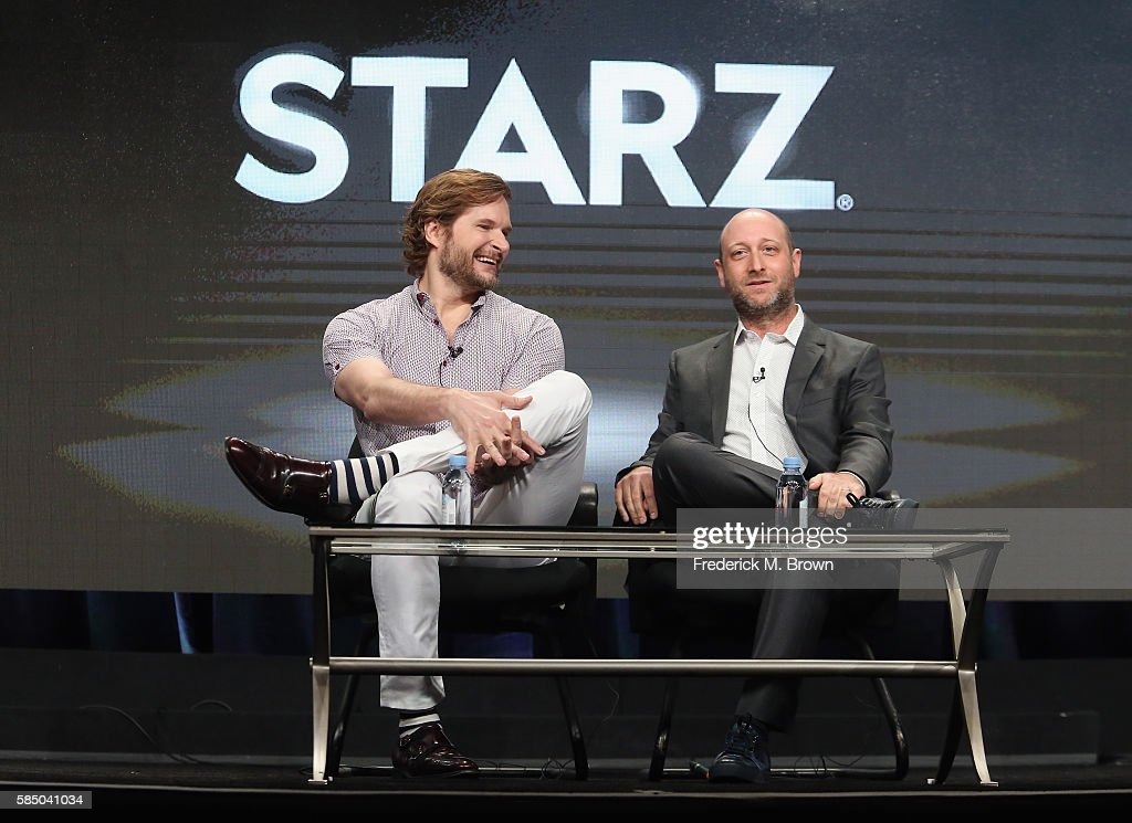 Writer/showrunner/executive producer Bryan Fuller and Writer/showrunner/executive producer Michael Green speak onstage during the 'American Gods' panel discussion at the Starz portion of the 2016 Television Critics Association Summer Tour at The Beverly Hilton Hotel on August 1, 2016 in Beverly Hills, California.