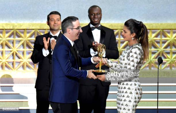 Writer-TV personality John Oliver accepts the Outstanding Variety Talk Series award for 'Last Week Tonight with John Oliver' from actor Priyanka...