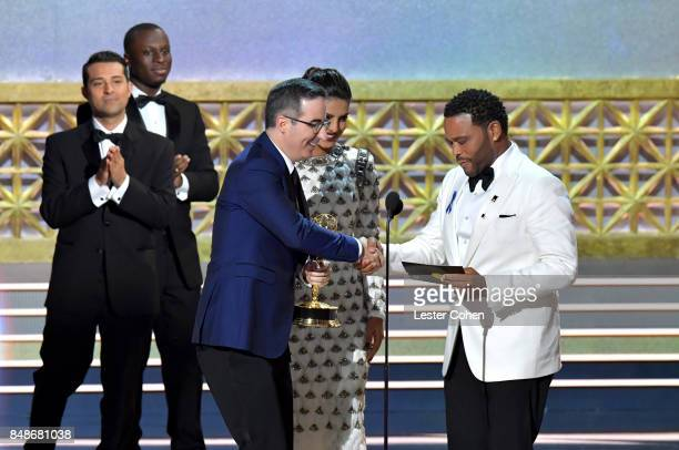 Writer-TV personality John Oliver accepts the Outstanding Variety Talk Series award for 'Last Week Tonight with John Oliver' from actors Priyanka...