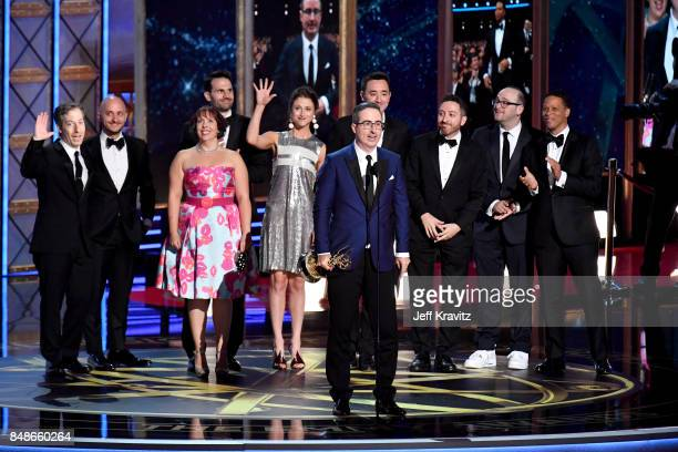 Writer/TV personality John Oliver and crew accept the Outstanding Writing for a Variety Series award for 'Last Week Tonight with John Oliver' onstage...
