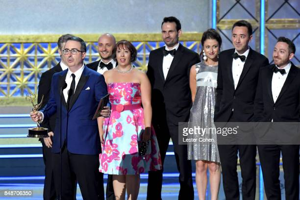 Writer-TV personality John Oliver and crew accept the Outstanding Writing for a Variety Series award for 'Last Week Tonight with John Oliver' onstage...