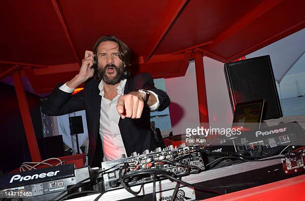 Writer/TV presenter Frederic Beigbeder performs during the Frederic Beigbeder DJ Set at Martini Terrace 65th Annual Cannes Film Festival on May 17...