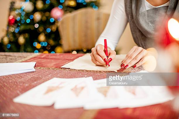 Christmas card stock photos and pictures getty images writing a christmas card m4hsunfo