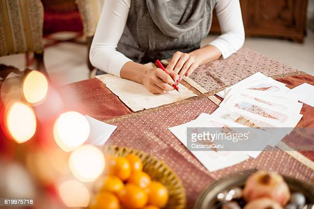 writing a christmas card - holiday card stock photos and pictures