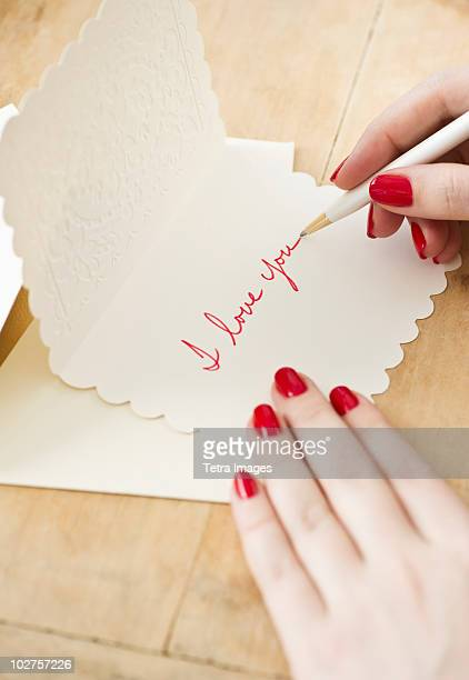 writing a love letter - love you stock photos and pictures