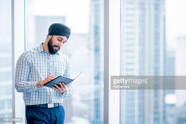 writing a plan - turban stock pictures, royalty-free photos & images