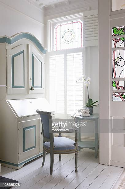 writing bureau in study with america shutters,  london - floorboard stock photos and pictures