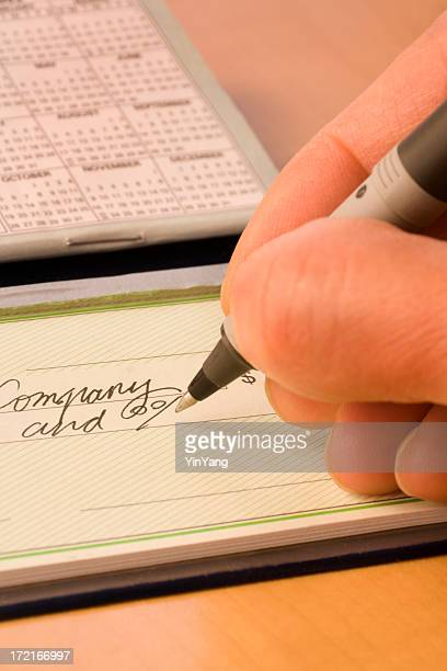 writing check close-up vt - paid stock pictures, royalty-free photos & images