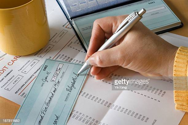 Writing Check Paying Credit Card Debt and Bills for Finance