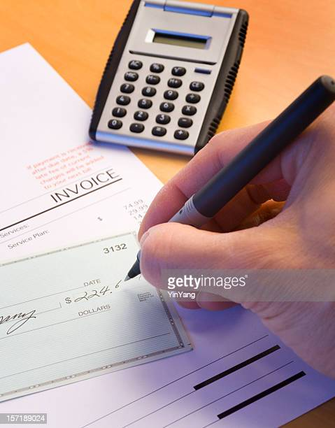 writing checks for paying bills and credit debts for personal finance - monthly event stock pictures, royalty-free photos & images