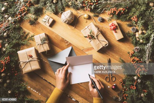 Writing Christmas cards table top flat lay