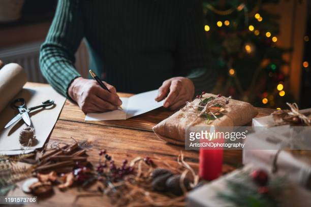 writing christmas greeting cards - christmas decore candle stock pictures, royalty-free photos & images