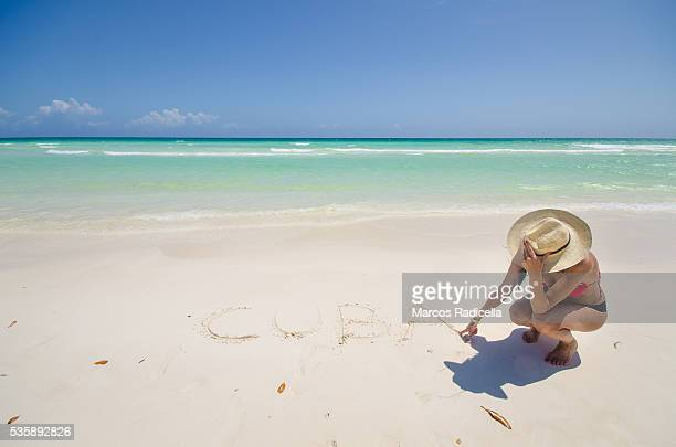writing cuba in the beach, cayo coco, cuba. - radicella stock photos and pictures