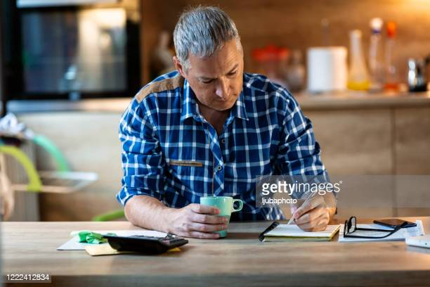 writing down things that are important - business plan stock pictures, royalty-free photos & images