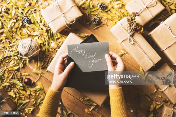 Writing greeting cards, New Year table top flat lay