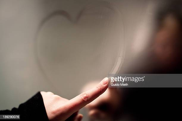 writing heart on steamy mirror - mirror steam stock photos and pictures