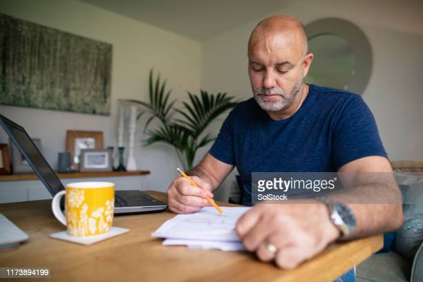 writing his plans down - work from home stock pictures, royalty-free photos & images