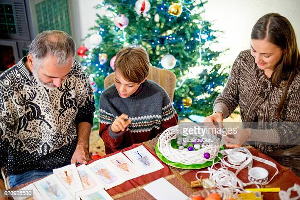Writing Homemade Christmas cards and making the Wreath