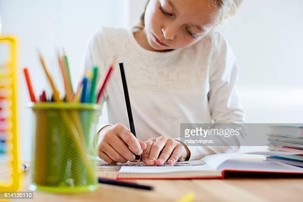 Writing homework at her desk