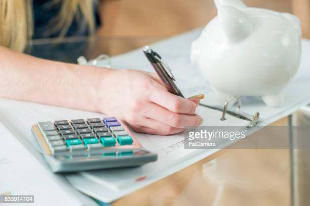 writing in binder - home finances stock photos and pictures