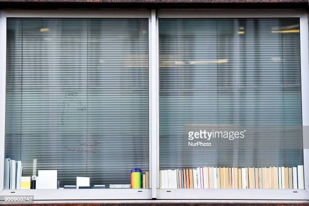 Writing is seen on the glass of a window at the London headquarters of Cambridge Analytica London on March 21 2018 Authorities are currently seeking...